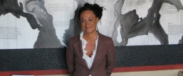 FILE - In this July 24, 2009, file photo, Rachel Dolezal, a leader of the Human Rights Education Institute, stands in front of a mural she painted at the institute's offices in Coeur d'Alene, Idaho. Dolezal, now president of the Spokane, Wash., chapter of the NAACP, is facing questions about whether she lied about her racial identity, with her family saying she is white but has portrayed herself as black. (AP Photo/Nicholas K. Geranios, File)